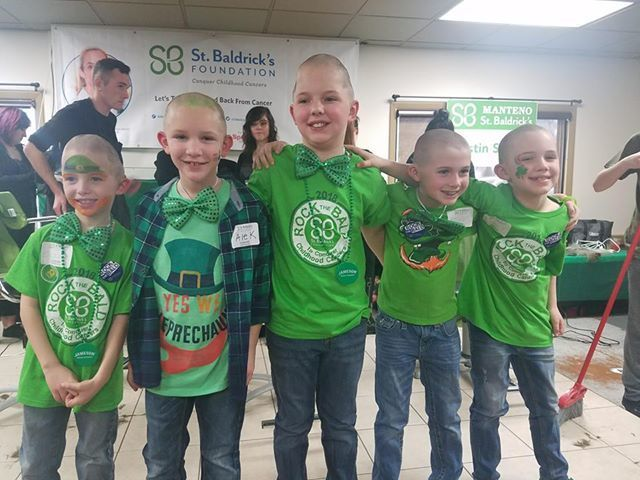 Kids shave heads to raise money